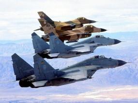 Обои Колонна истребителей F-16 и МиГ-29: Истребители, Военные самолеты, МиГ-29, F-16, Истребители