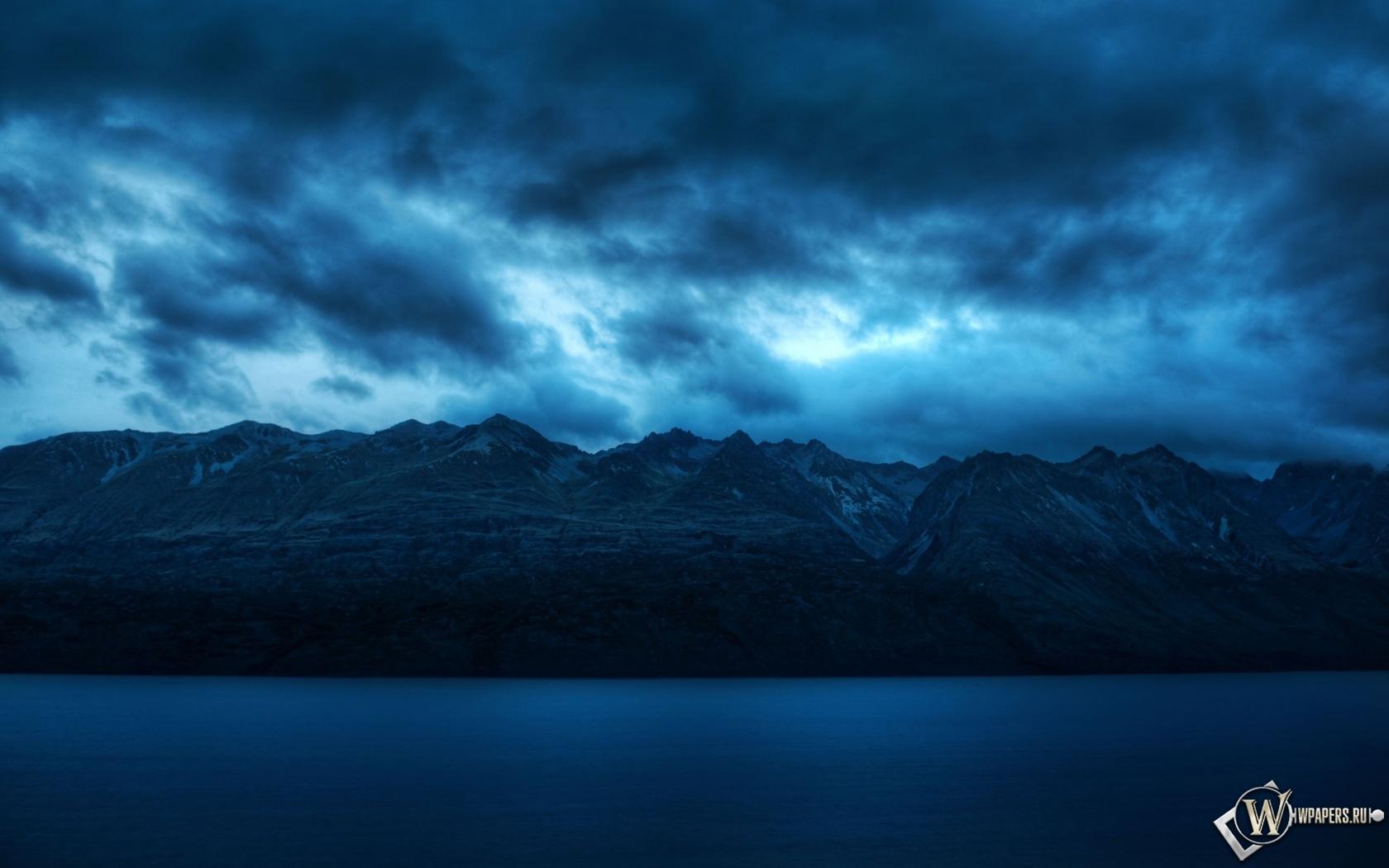 Обои облака над горами на рабочий стол