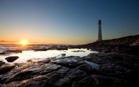 Обои Light House: Солнце, Камни, Берег, Маяк, Вода и небо