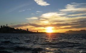 Обои Закат над морским берегом: , Вода и небо